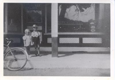 Photograph- Dawna & Tom Weaver in front of Weaver Bros. General Store, Lorne Park