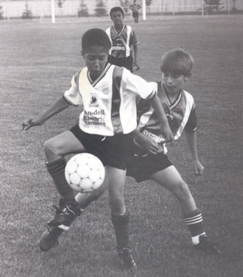 Photograph- Young soccer players playing at a unidentified field