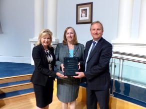 Mayor presenting award of excellence to City Solicitor