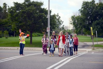 Image of children, Mayor Bonnie Crombie, Councillor Saito and Councillor Ras crossing street