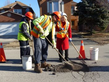 Mayor Bonnie Crombie with Mississauga City Crew Filling Pot Hole