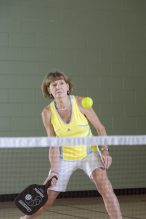 Female playing pickleball