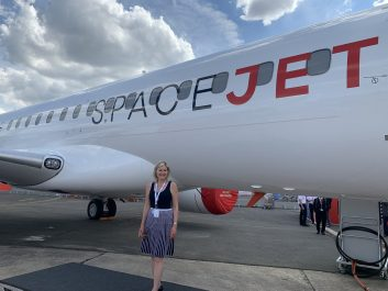 Mayor Bonnie Crombie in front of airplane