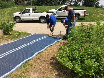 Mississauga Parks staff installing the accessible beach route at Lakefront Promenade Park