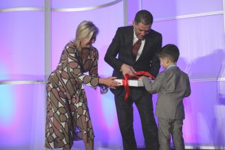 Dr. Mohamad Fakih unwraps key to the city alongside his son and Mayor Bonnie Crombi