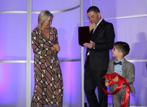 Dr. Mohamad Fakih reacts to receiving the key to the city alongside Mayor Bonnie Crombie and his son.
