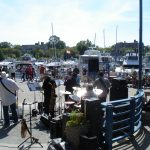 Band performing on docks during jazz festival