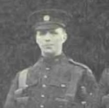 Black and white portrait of John in uniform