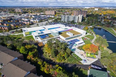 Aerial view of the Meadowvale Community Centre and Library complex surrounded by trees and green space