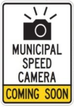 White and yellow traffic sign indicating a municipal speed camera is coming soon to an area