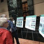 Residents reading information board at City Hall