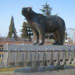 Sculpture of a black bear standing on a canoe