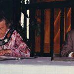 Mississauga Mayor Hazel McCallion and Kariya Mayor sitting at a table signing partnership agreement