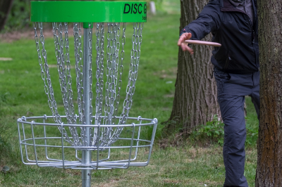 A person playing disc golf.