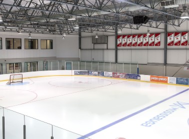 An ice rink with advertising hoardings.