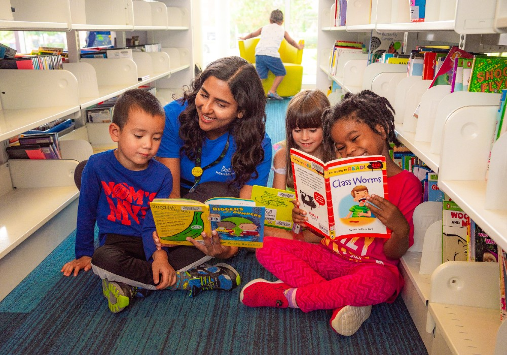 A group of children reading at the library.