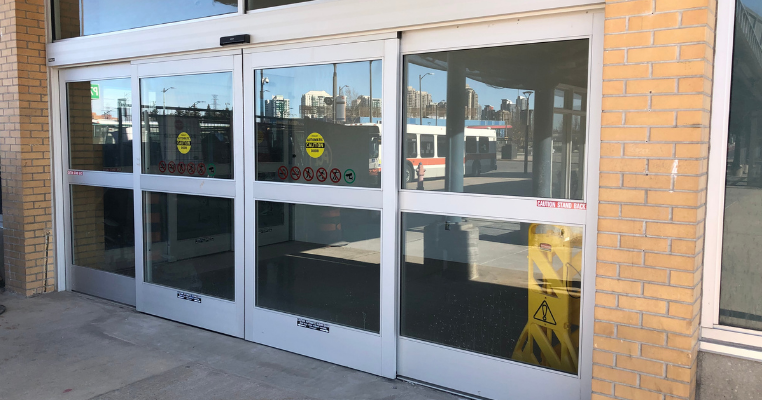 Exterior of the closed sliding doors on a sunny day.