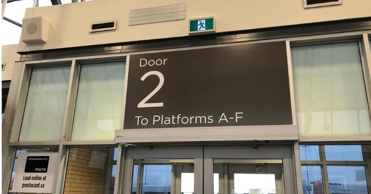 Large sign above door that reads Door 2 To Platforms A-F