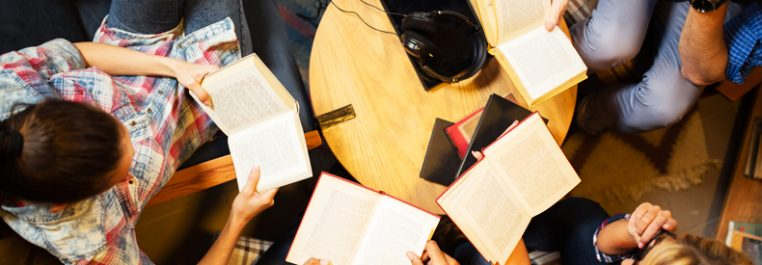Group of 4 people reading books