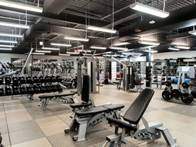 Interior of fitness centre showing rows of exercise equipment
