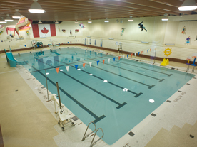 Indoor pool showing deck, slide and swim lanes