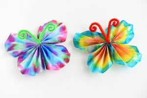 Coffee filtered dye butterflies held together with a pipe cleaner shaped like antenna