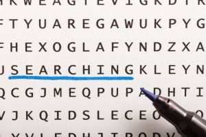Word search, puzzle. Close up of letters on canvas. Concept about finding, searching, looking for.