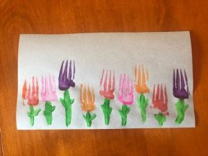 Painting craft with fork and paint. Spring flowers