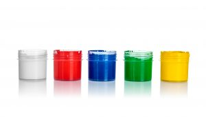 open cans of paint, yellow, green, blue, red, white colours