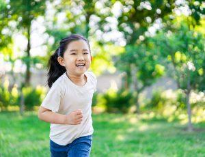 Cute little girl running outoors