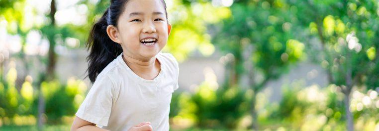 Cute little girl running outdoors