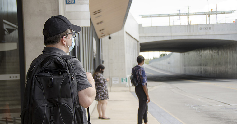 Customers waiting at a transitway station for the bus