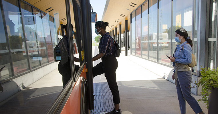 Customers boarding the bus at a transitway station