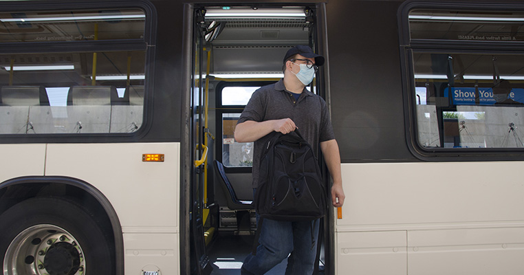 Customer exiting the rear doors of the bus