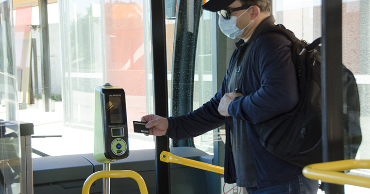 Customer tapping their presto card when boarding the bus
