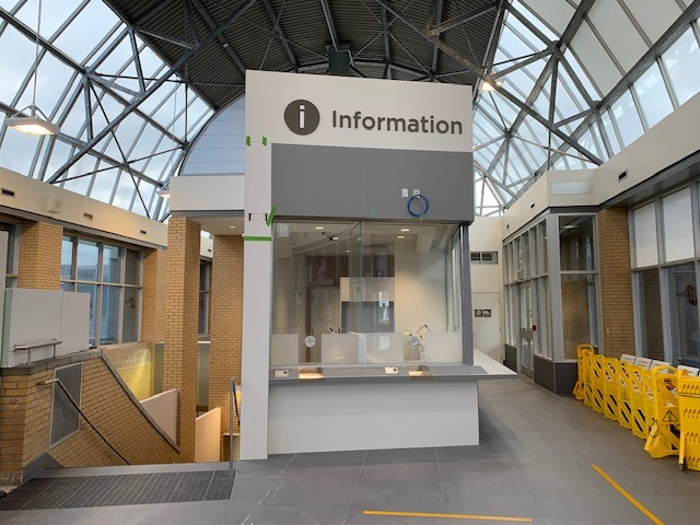 Newly renovated booth with information sign next to stairway, inside CCTT station