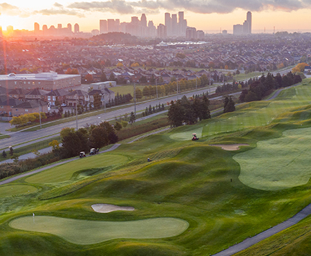 Aerial view of BraeBen holes 16 and 18 with City of Mississauga skyline in the distance.