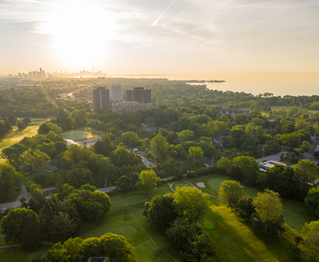 Aerial view of Lakeview Golf Course with City of Toronto skyline in the distance.