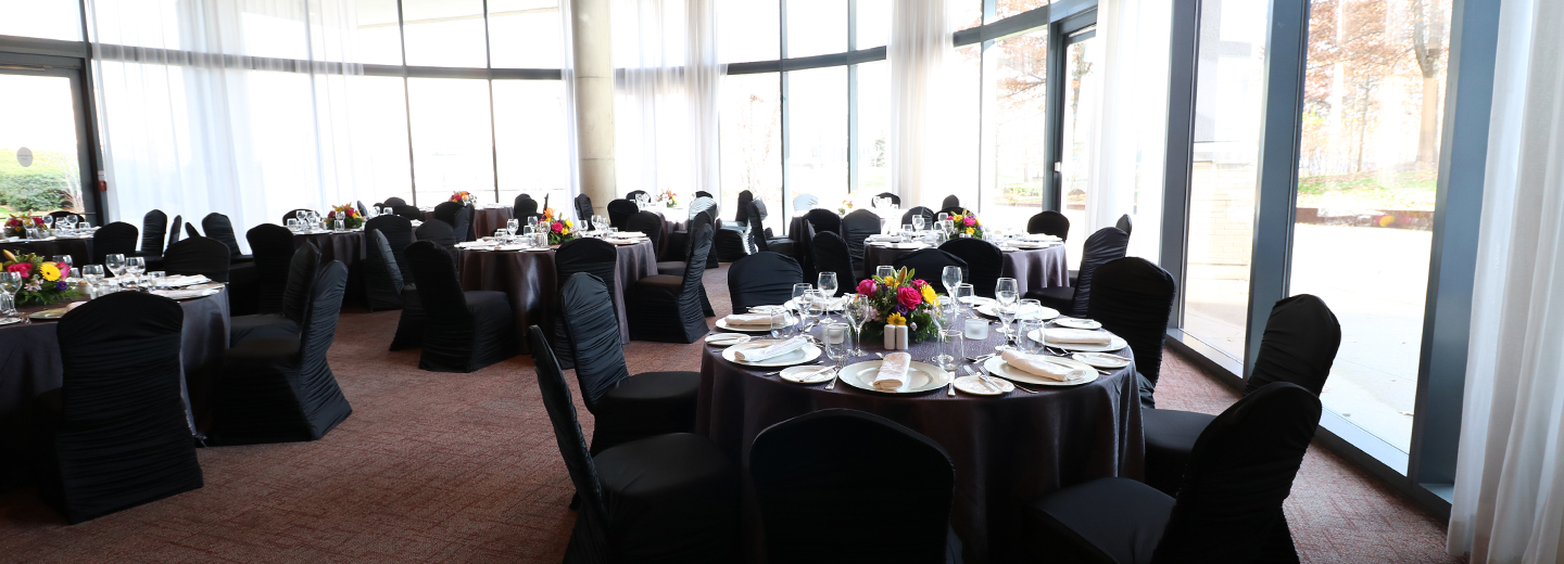 Banquet table setup with Floor to ceiling windows view