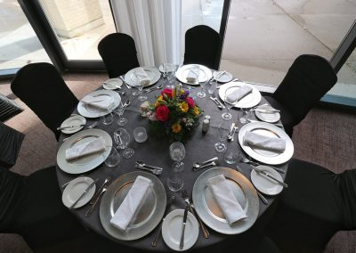 Black and silver linens with tableware